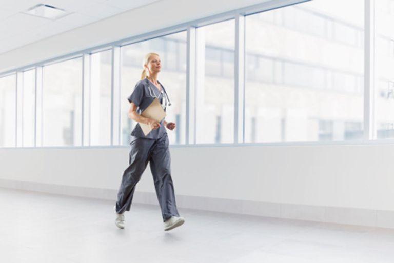 Caucasian nurse walking in hospital