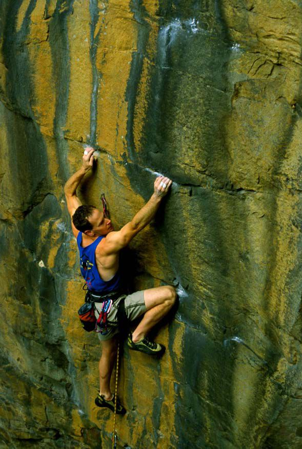 """Eric Horst crimping up """"Tongulation"""" at Bubba City in New River Gorge, West Virginia."""