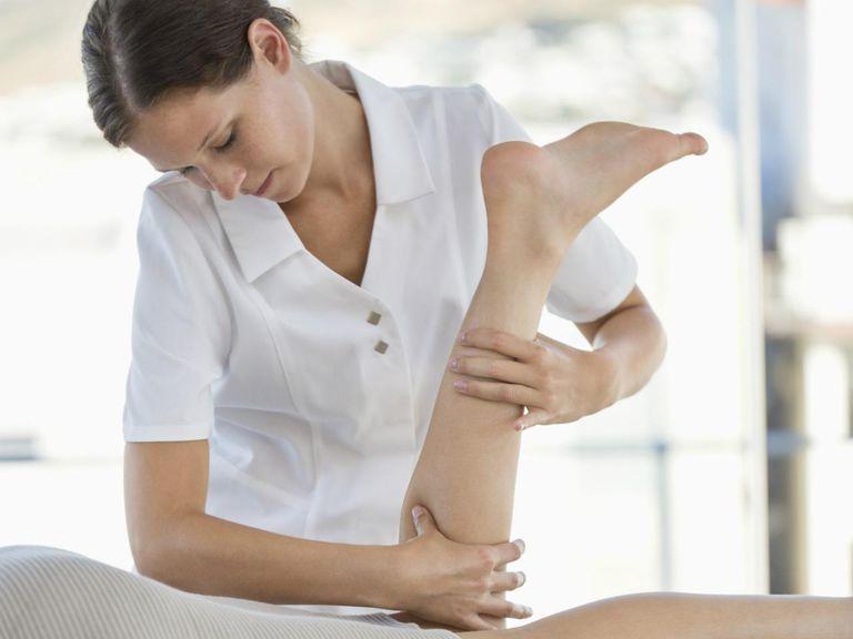 Woman receiving leg massage from a massage therapist