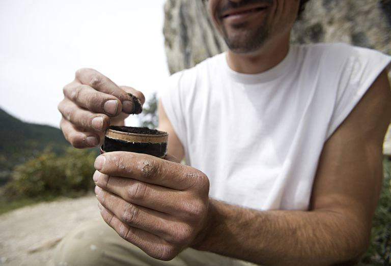 Man pulls chewing tobacco from can