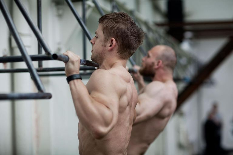 Two men training in crossfit gym