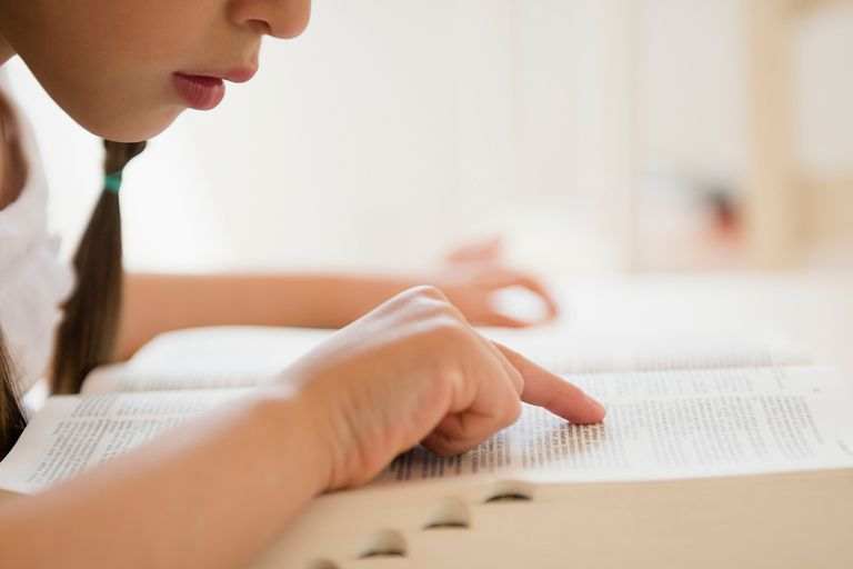 Girl reading dictionary