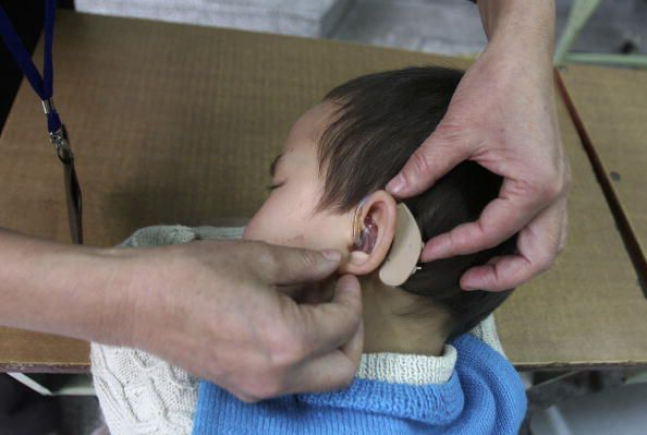 Photo of a child getting a new hearing aid