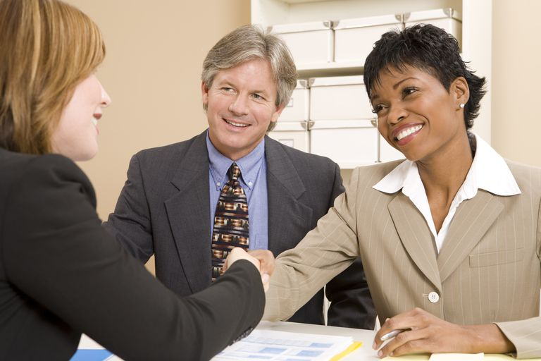 Three people involved in a business interview