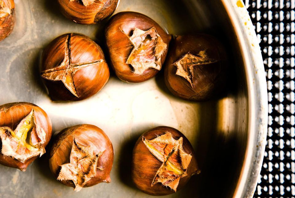 Oven roasted chestnuts in a pan