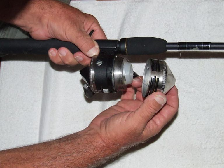 First step in Putting Line On A Spin Cast Reel remove the cover