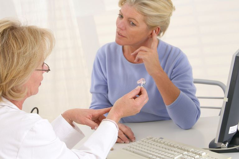 Woman talking to doctor about hearing aids