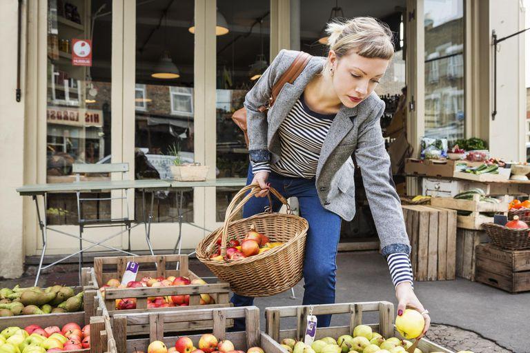 Woman choosing apples at a farmers market