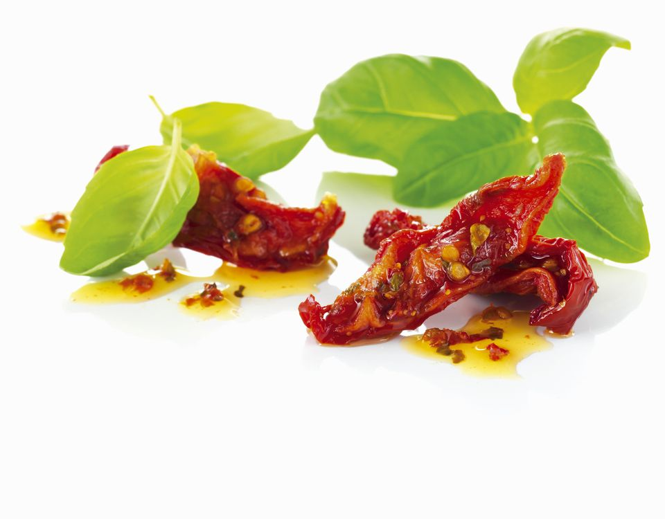 Dried tomatoes and fresh basil leaves