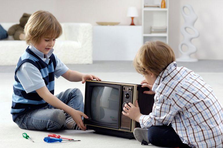 Two Boys Taking TV Apart