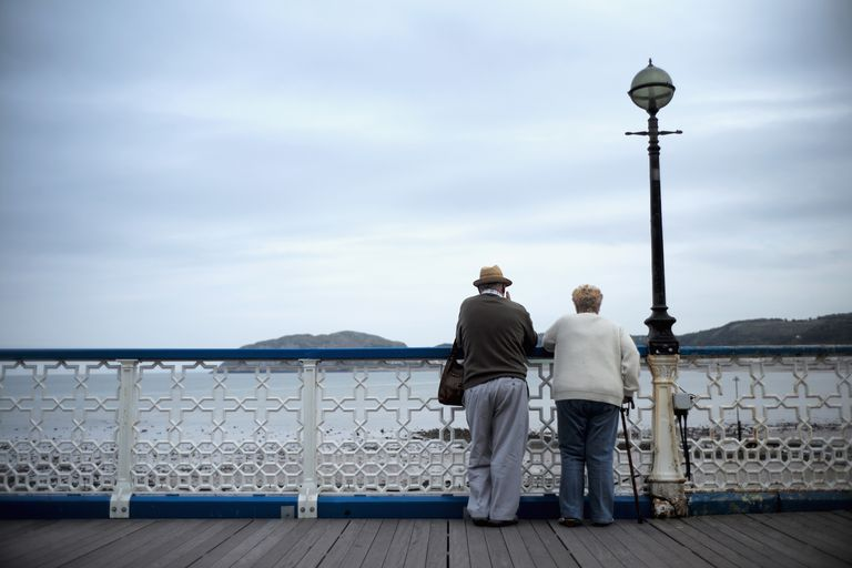 Retired couple looking at the water