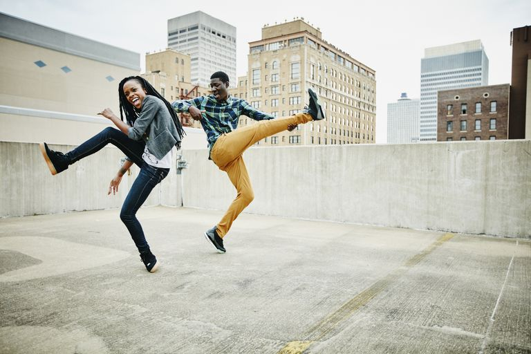 Couple dancing together on rooftop of building