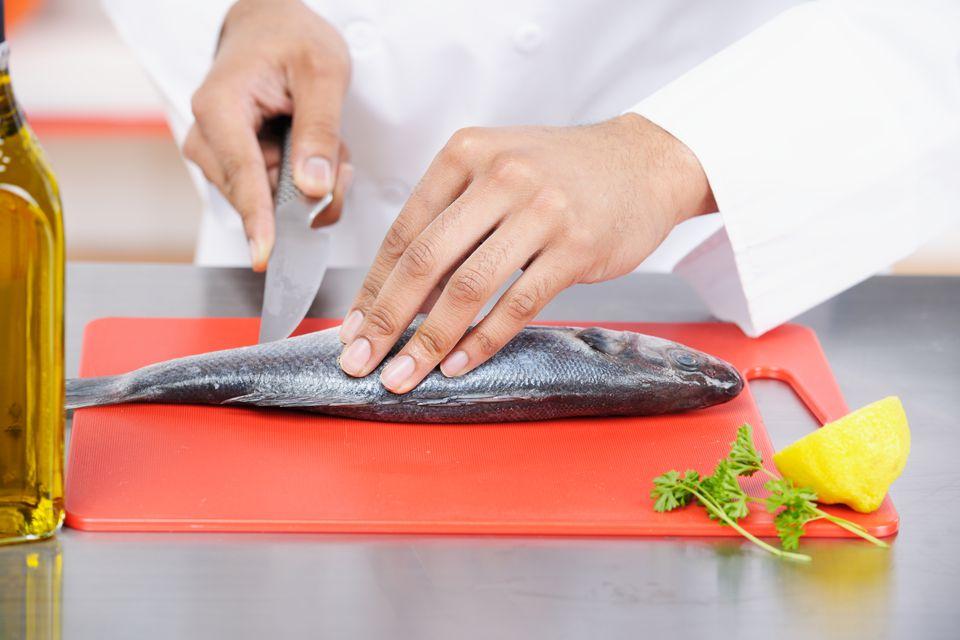 Biracial Chef Peparing Fish