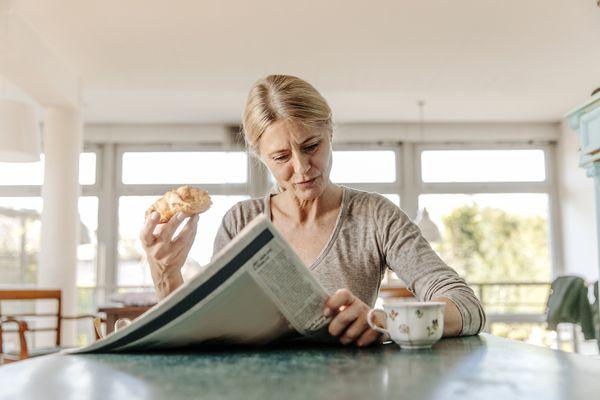 Woman at home having breakfast