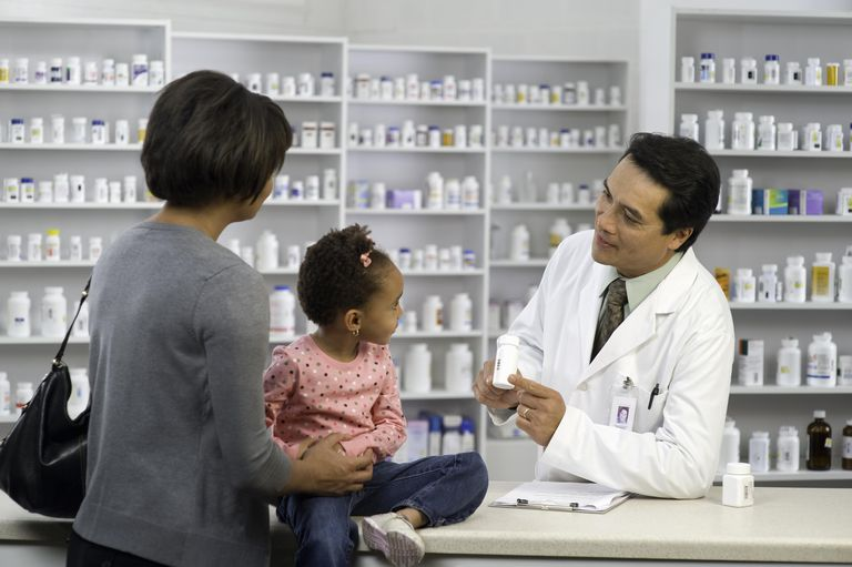 Mother and Daughter with Pharmacist