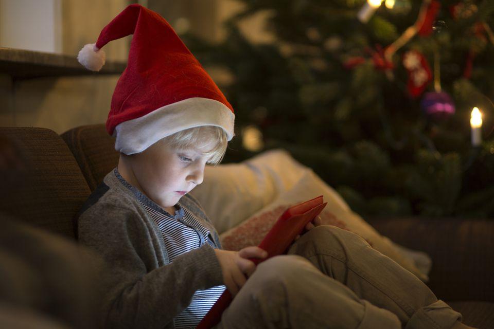 boy in Santa hat on tablet