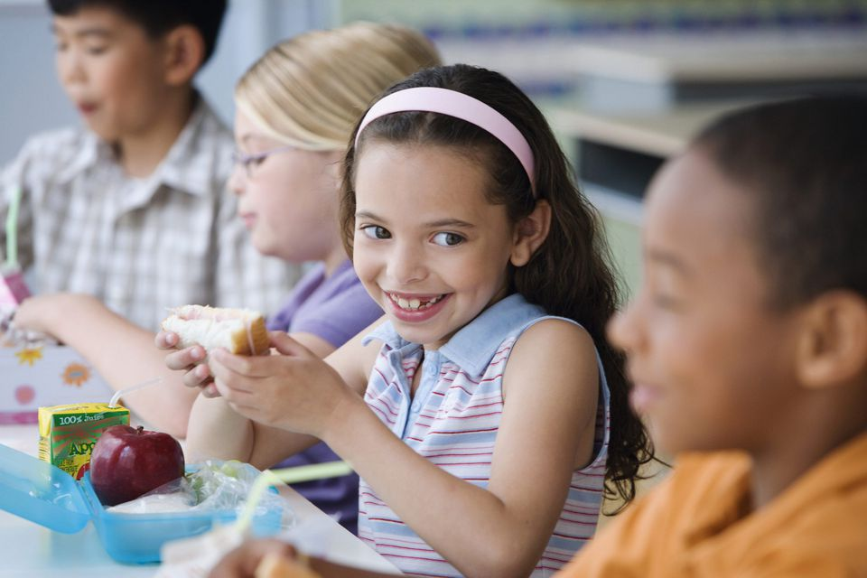 A picture of a child eating lunch at school