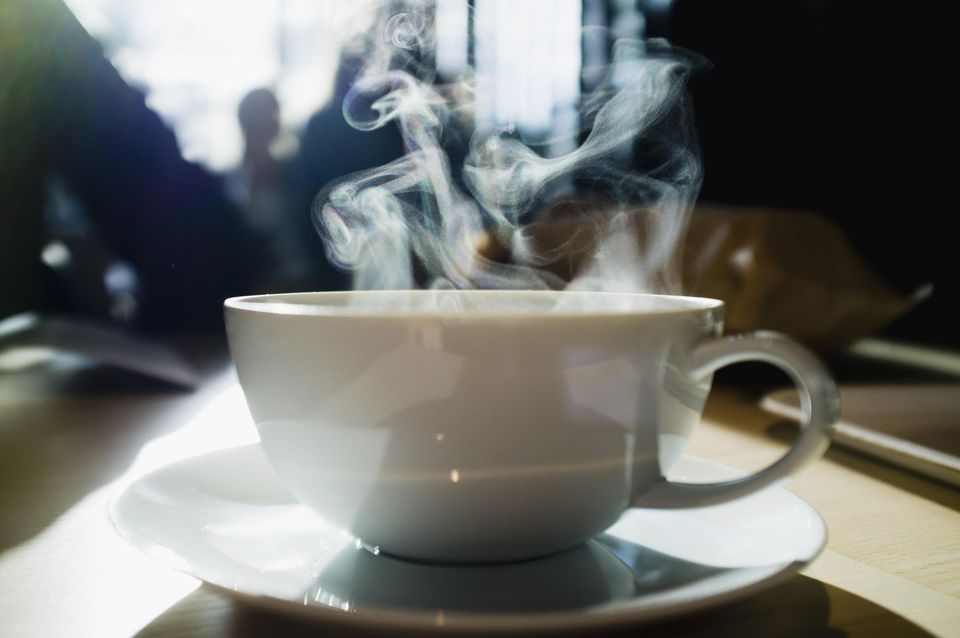A coffee cup with steam coming out