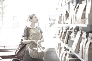 Woman shopping in delicatessen shop.