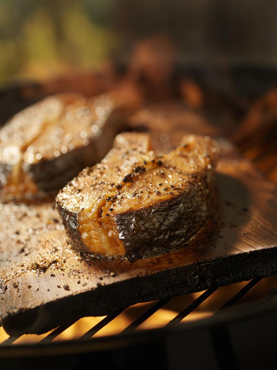 A close-up of plank grilled salmon steaks