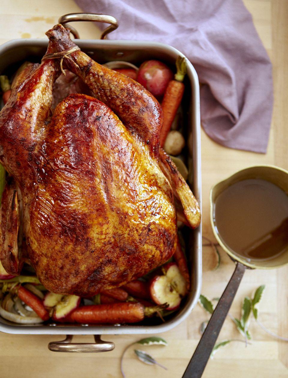 roast turkey and vegetables in roasting pan