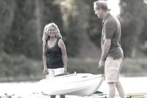 Couple carrying kayak