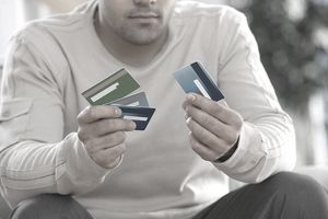 The pros and cons of a credit card balance transfer man choosing between multiple credit cards reheart Image collections