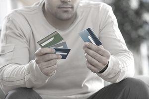 Man choosing between multiple credit cards