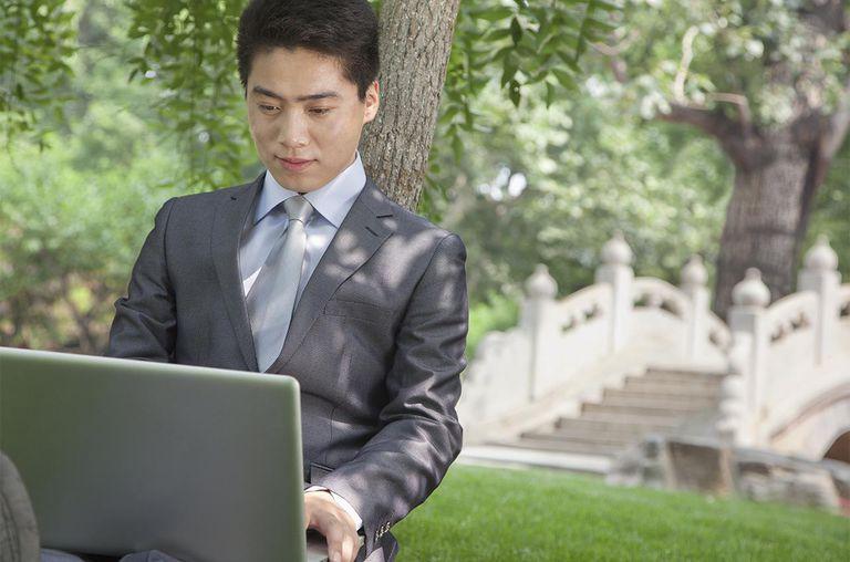 Business Man using laptop in Ditan Park