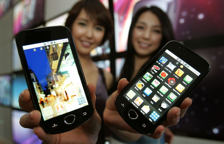 Figure 1-1: A screen shot showing two ladies holding two Android phones.