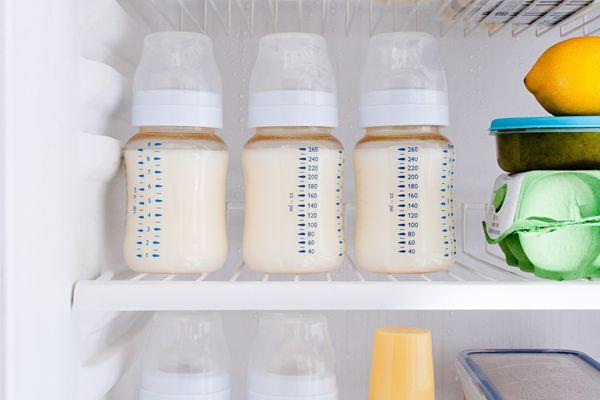 Bottles of breast milk in a refrigerator