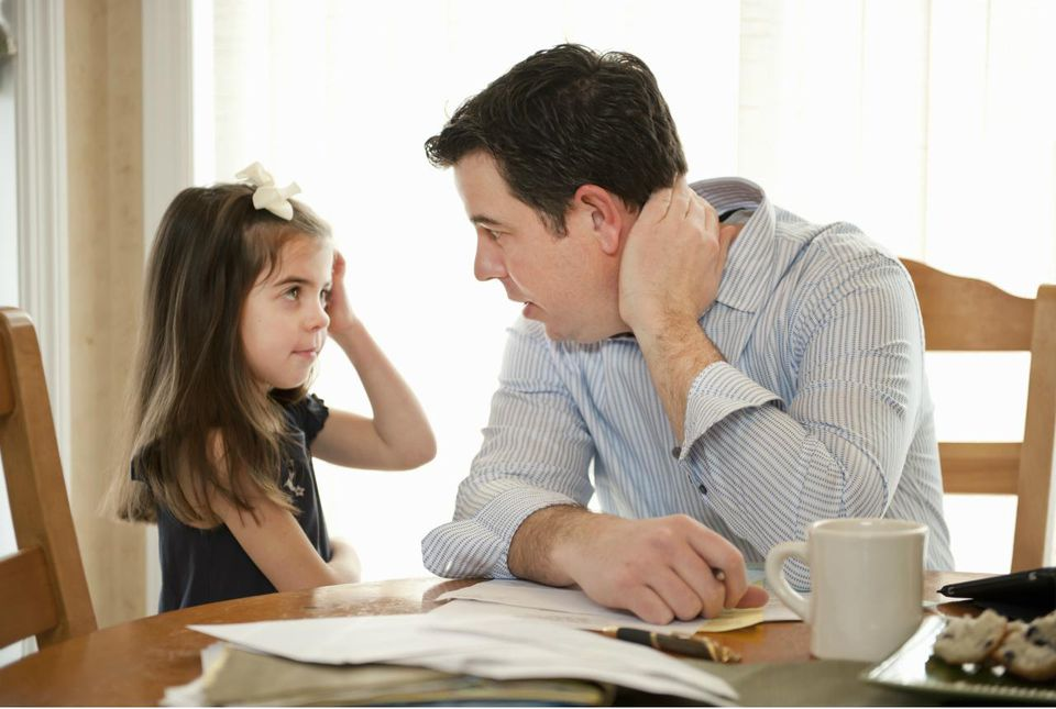 Father talking to Daughter While Working