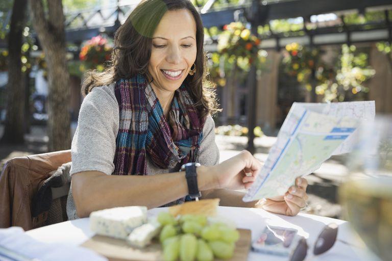 woman at cafe looking at map