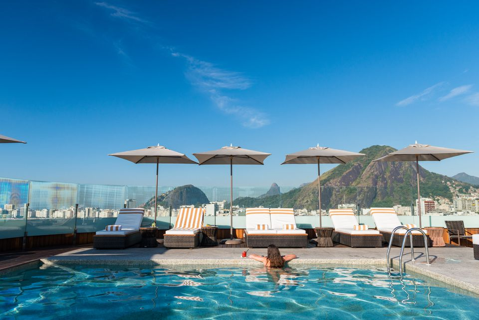 A swimmer looks over the edge of the pool at the Porto Bay Rio Internacional