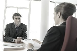 Business woman interviewing man