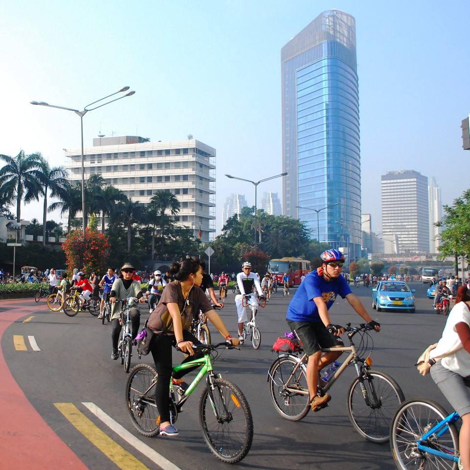 Locals biking around Bundaran HI in Central Jakarta