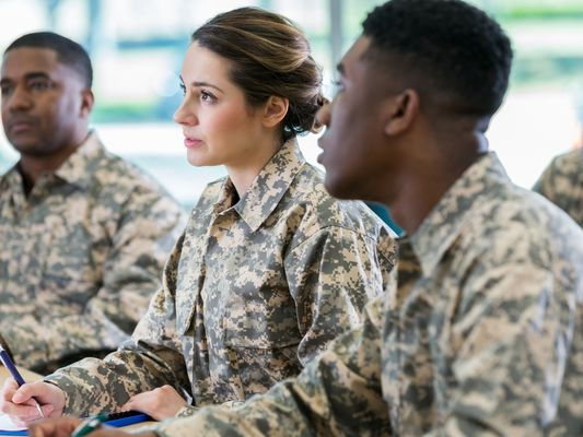 Attentive soldiers in college class