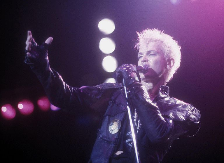 Former punk rocker Billy Idol performs live in California during summer 1984.
