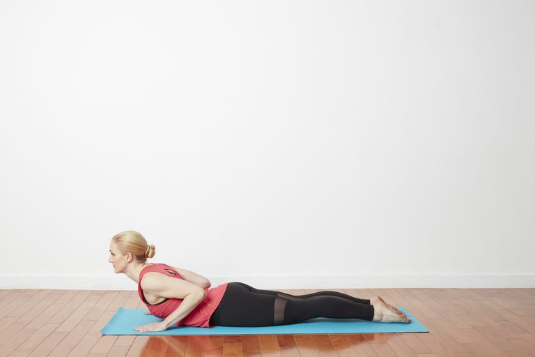 Woman in low cobra yoga pose