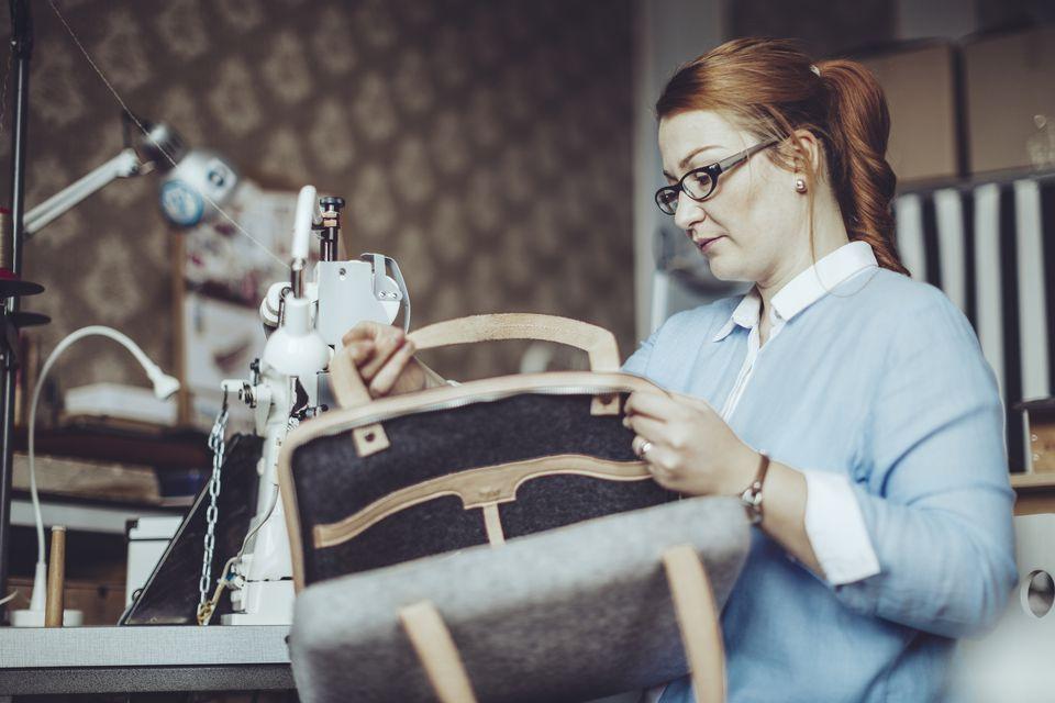 Woman sewing bag