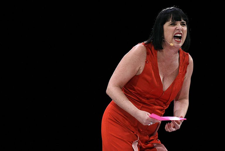 Playwright Eve Ensler addresses the crowd before performing readings of the Vagina Monologues during V TO THE TENTH at the New Orleans Arena on April 12, 2008 in New Orleans, Louisiana. V TO THE TENTH celebrates 'V-Day's 10th Anniversary' and was chosen to be held in New Orleans due in part to the effects Hurricane Katrina had on women in the region.