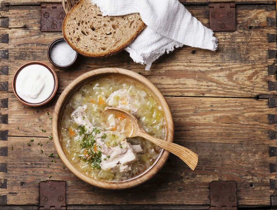 Homemade cabbage soup shchi with sour cream and bread