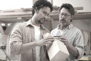 An apprentice carpenter with his teacher