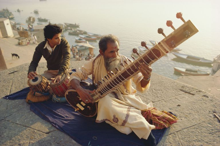 Musicians playing the Sitar and Tabla on the banks of the Ganges