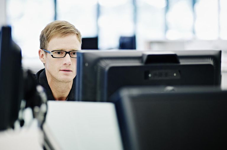 Businessman working on computer at workstation