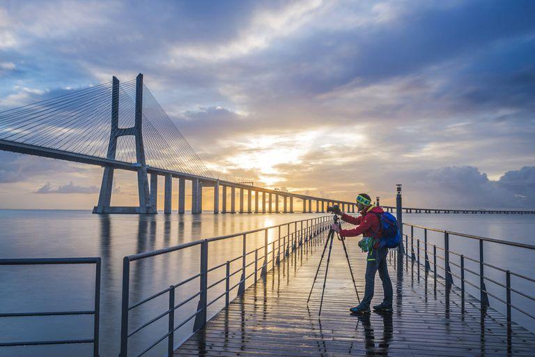 Photographer taking a creative shot of a bridge.
