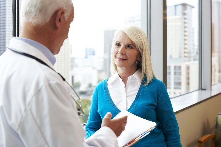 Older woman talking with her doctor