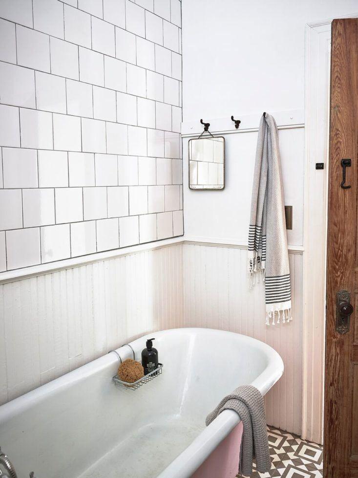 white tile bathroom beadboard pink clawfoot tub