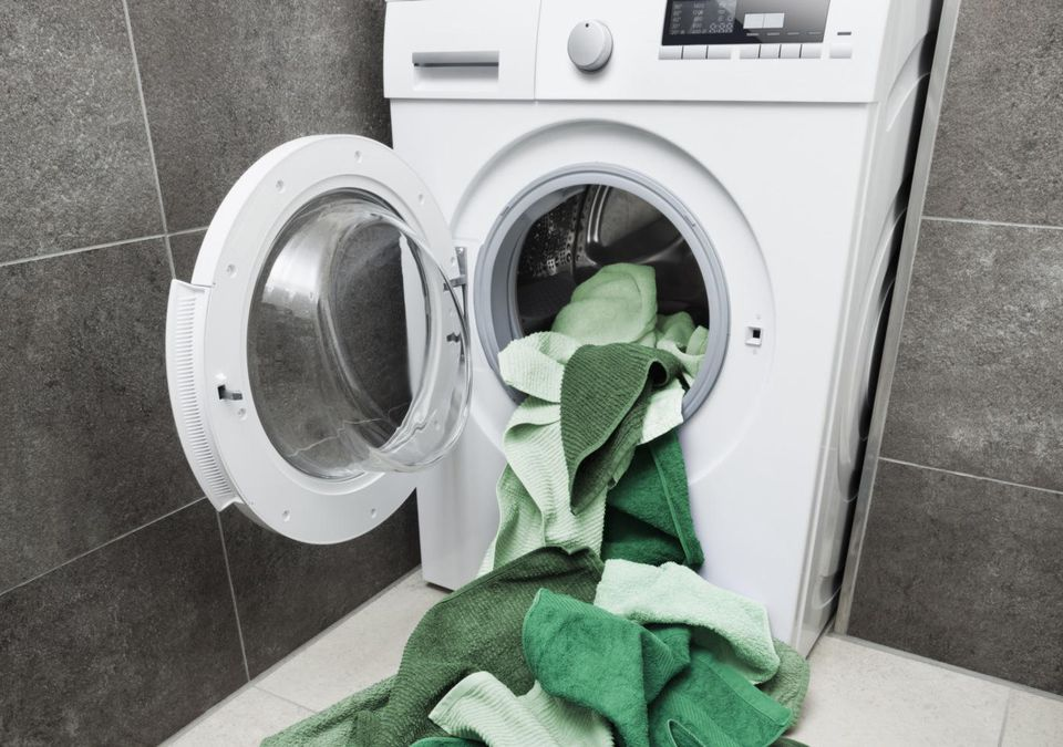Green laundry coming out of washing machine