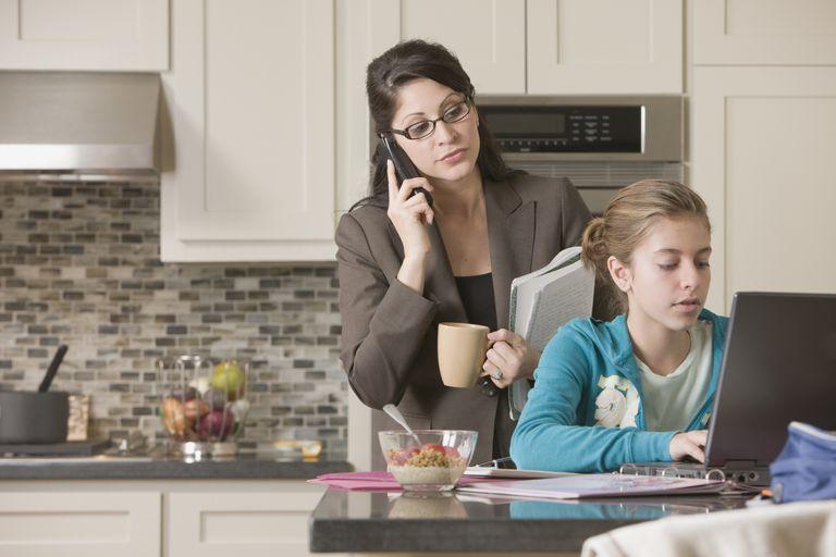 Working parent helping homeschool child